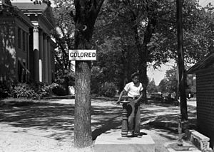 An African-American child at a segregated drin...