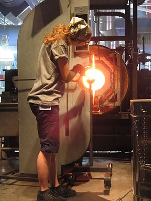 Glassblower and glory hole at the glassblowing...