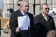 Standing with Israeli Minister of Defense Ehud Barak, Netanyahu holds an Iranian instruction manual for the anti-ship missile captured in Victoria Affair, March 2011