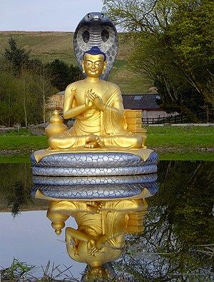 Golden statue of Nagarjuna at Samye Ling Monas...