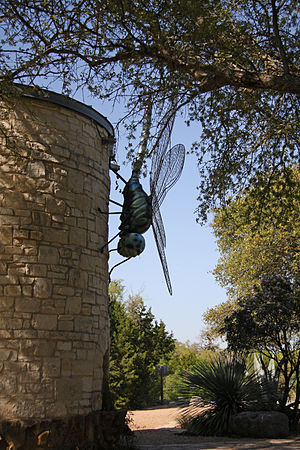 English: Giant dragonfly sculpture on side of ...