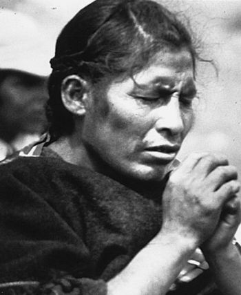 A Bolivian aymara woman praying