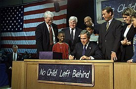 President Bush signing the bipartisan No Child Left Behind Act at Hamilton H.S. in Hamilton, Ohio.