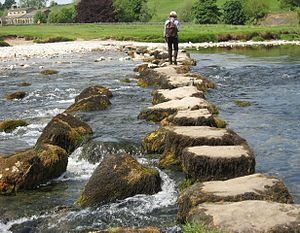 Low view of Linton stepping stones over River ...