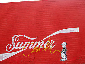 The Enmore stencil wall was 'sold' to the Coca...