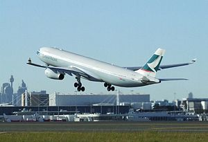 Cathay Pacific A330 B-LAE climbing off runway ...