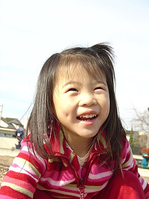 Asian (Oriental) American girl with dimples.