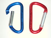 These inexpensive decorative carabiners have an anodized aluminium surface that has been dyed and are made in many colors.