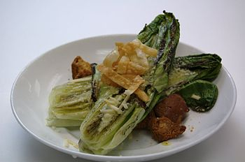 English: A grilled Caesar Salad made with wood...