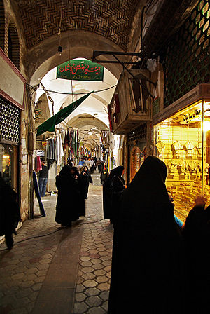The Bazaar of Kashan, Iran, with women wearing...