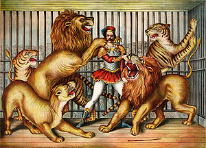 ;Lion tamer Lion tamer in cage with two lions,...