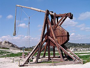 A trebuchet uses the gravitational potential e...