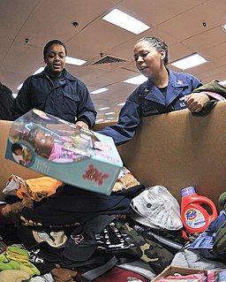 U.S. Navy Logistics Specialist donates items
