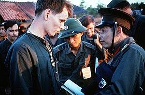 English: US POWs and NVA officers during Vietn...