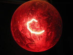 Red light bulb in darkness