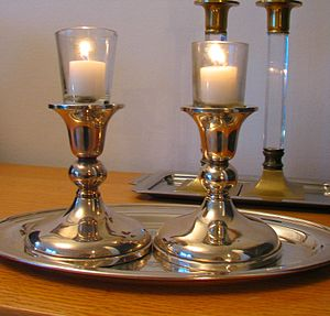English: Silver candlesticks used for candle-l...