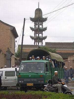 Worshippers leaving a small mosque in the sout...