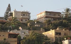 Houses in Hamaam, a Beduin village in Israel, ...