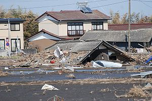 English: A home buried by the tsunami a month ...