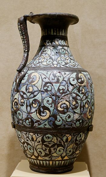 Handled ewer. Copper alloy with champlevé enam...