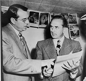 John Rosselli (right) checks over a writ of ha...