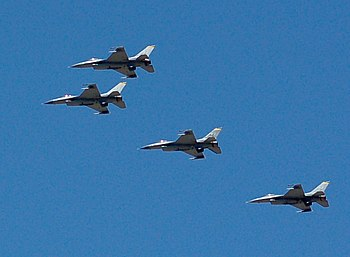 English: Four F-16 fighter jets flying over th...