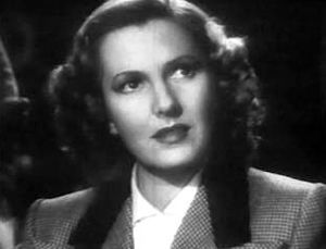 Cropped screenshot of Jean Arthur from the tra...