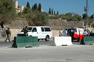 A Red Crescent ambulance is searched at an Isr...