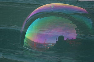 GGB is reflected in a soap bubble