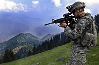 A soldier with the ISAF patrols the mountainous Kunar Province in 2006.