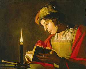 English: Young man reading by candlelight Sven...