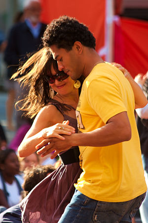 A couple dance to the band Merengada at London...