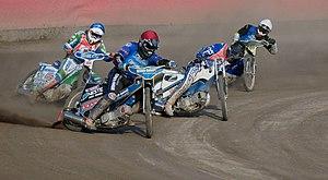 English: Speedwayriders riding in start number...