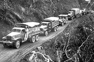 """from NARA :""""U.S.-built Army trucks wind a..."""