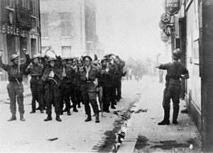 Canadian prisoners being led away through Diep...