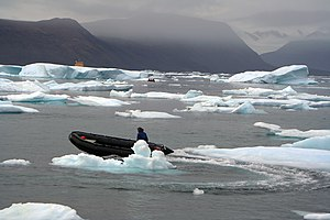 English: Zodiacs navigate between icebergs in ...