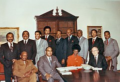 Rangel and twelve other African-American members of Congress posed around a table