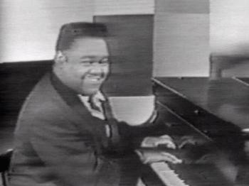 "A screenshot of Fats Domino singing ""Blue..."
