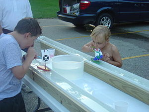 Cubscouts compete in a Raingutter Regatta race