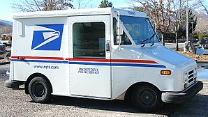 A small United States Postal Service truck see...