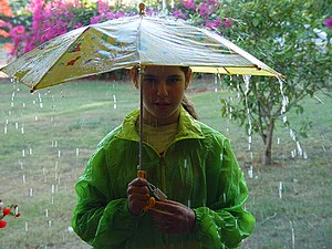 English: Maayan holds her umbrella (Israel, 2002)