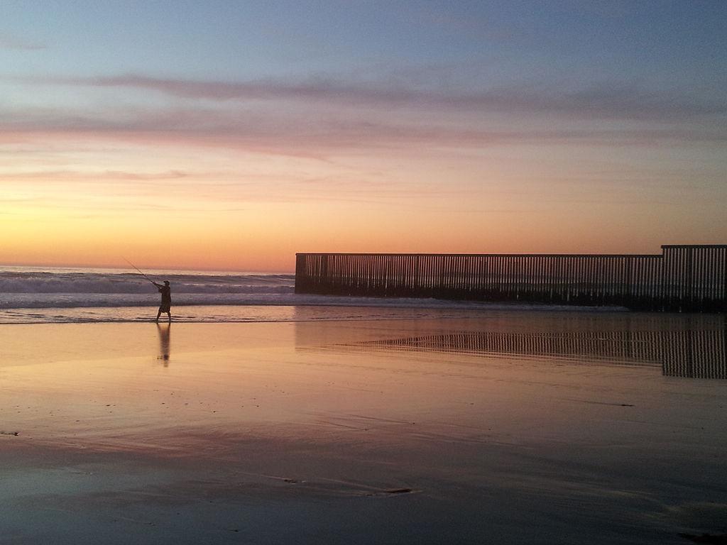 FilePlayas De Tijuana Fisherman At Border Fencejpg