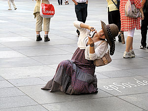 Asian Woman photographing with her digital cam...