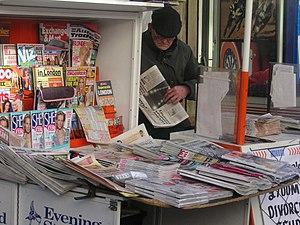 Newspaper vendor, Paddington, London, February...