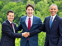 Peña Nieto, Canadian PM Justin Trudeau, and U.S. President Barack Obama doing a three-way hand shake which was described as awkward by international news media. Taken at North American Leaders' Summit in Ottawa, Canada, on 29 June 2016