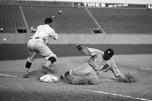 Ty Cobb safe at third after making a triple, 8...