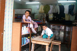 English: The kids in their mother store in Zan...