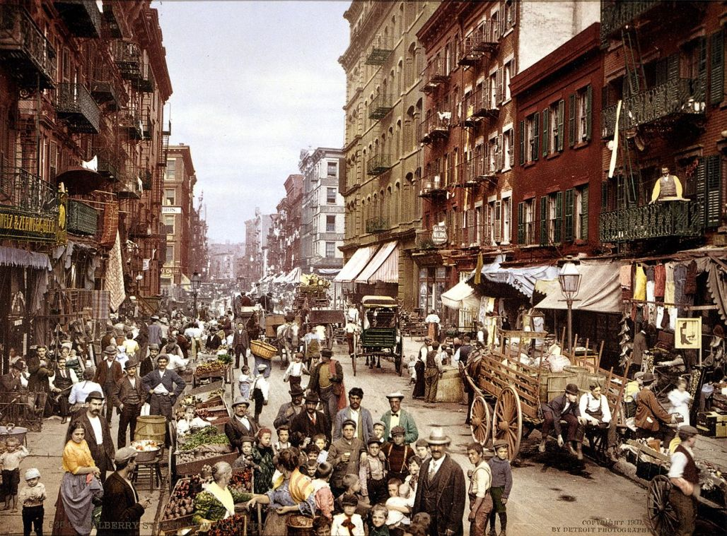 Little italy crowded with street vendors and wagons and people