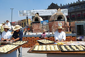 English: Making pan de muerto at a display ded...