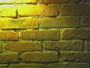 English: a yellow bricks wall in a restaurant